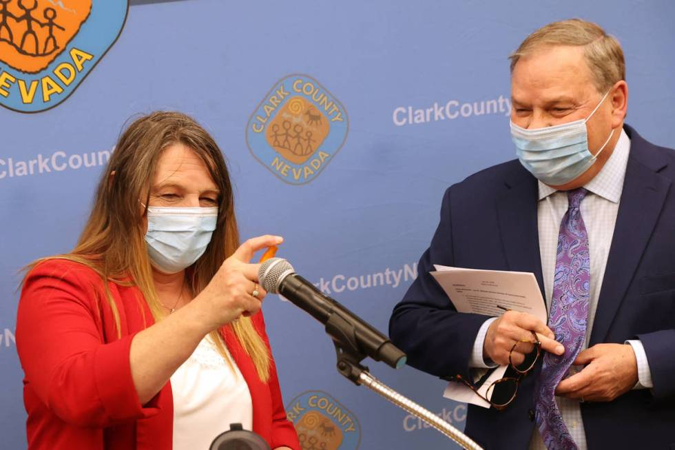 Clark County Commission Chairman Marilyn Kirkpatrick sanitizes the microphone as she and Dr. Mi ...