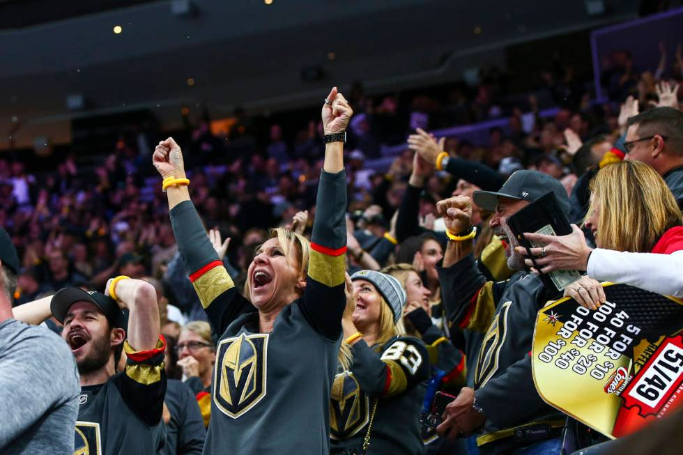 Golden Knights fans celebrate after a goal by Mark Stone during the first period of their NHL s ...
