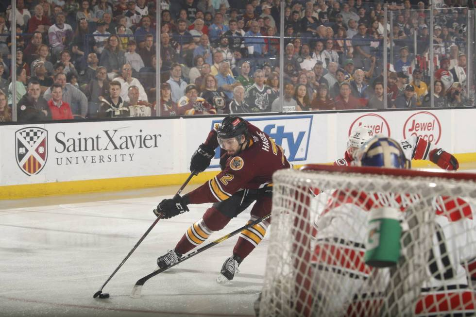 Chicago Wolves defenseman Nic Hague (2) moves toward the Charlotte Checkers goal in the first p ...