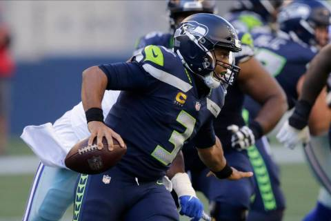 Seattle Seahawks quarterback Russell Wilson in action against the Dallas Cowboys during an NFL ...