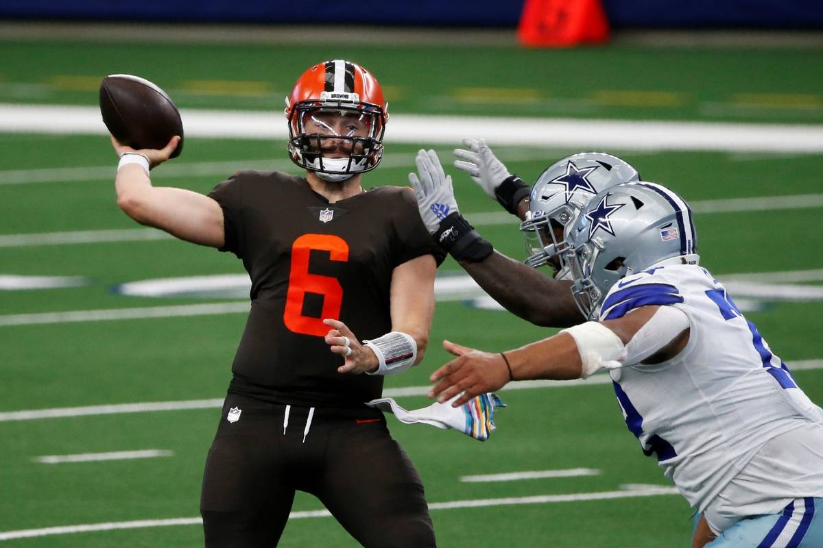 Cleveland Browns quarterback Baker Mayfield (6) throws a pass under pressure from the Dallas Co ...