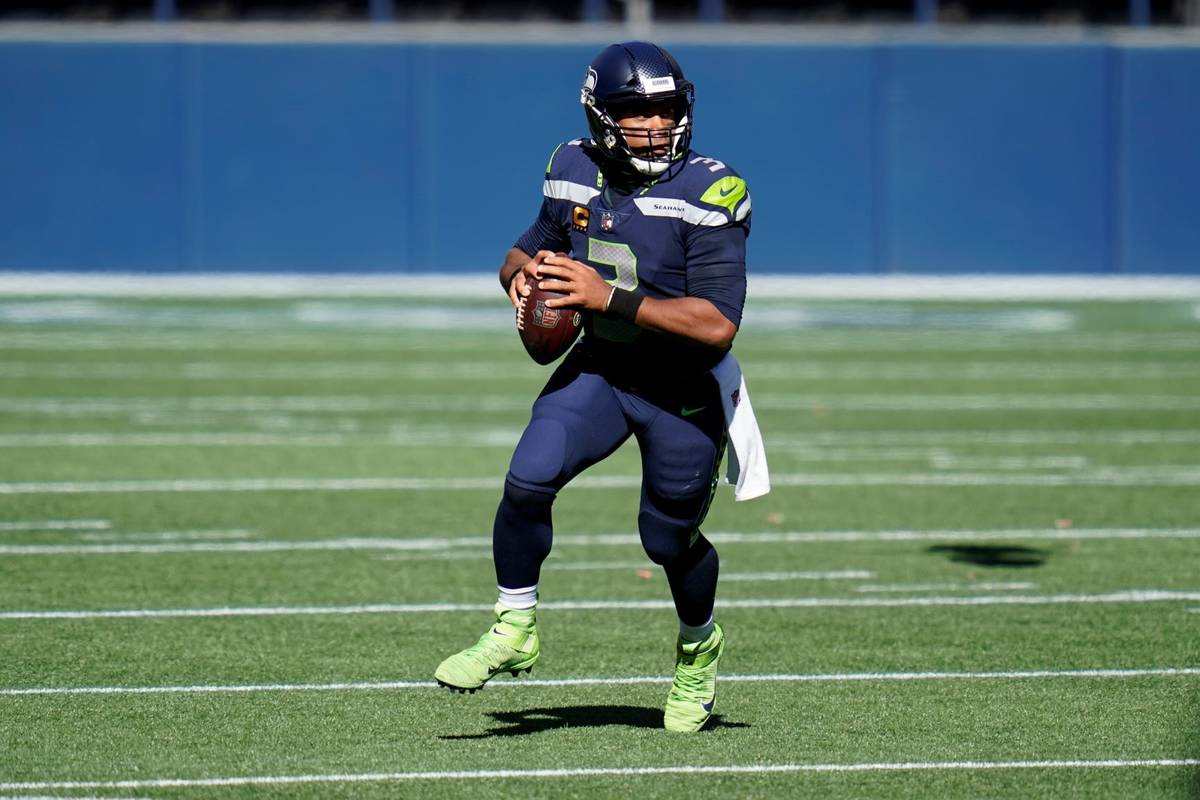 In this Sunday, Sept. 27, 2020, file photo, Seattle Seahawks quarterback Russell Wilson looks t ...
