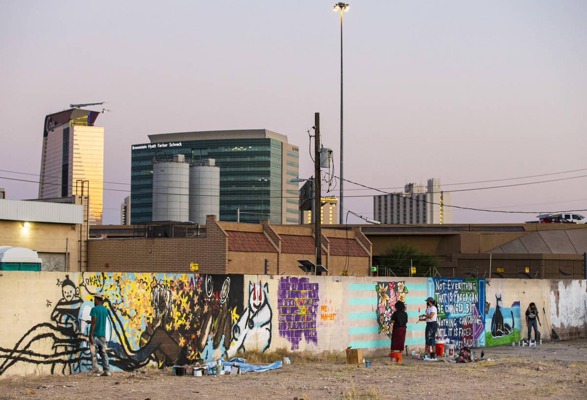 Artists work on murals at the site of the former Moulin Rouge in Las Vegas on Saturday, Oct. 3, ...
