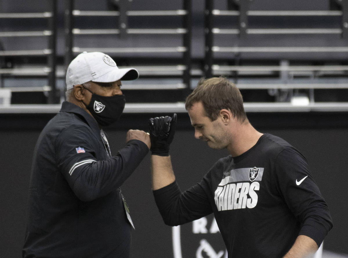 Las Vegas Raiders wide receiver Hunter Renfrow (13) greets Raiders staff during warms ups befor ...