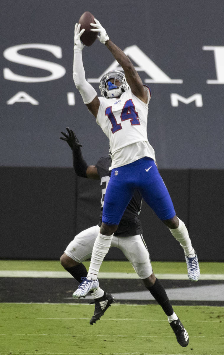 Buffalo Bills wide receiver Stefon Diggs (14) makes a catch over Las Vegas Raiders strong safet ...