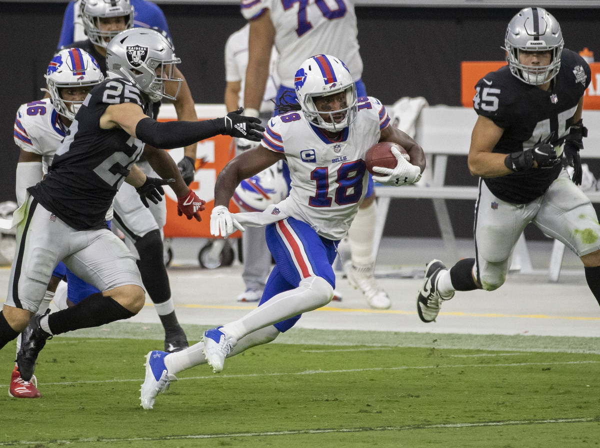 Buffalo Bills wide receiver Andre Roberts (18) streaks up field past Las Vegas Raiders free saf ...