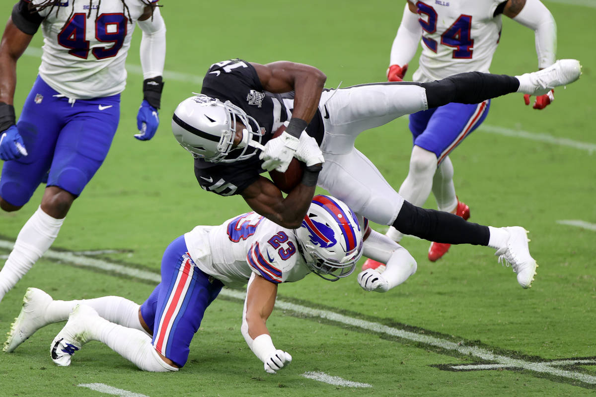 Buffalo Bills strong safety Micah Hyde (23) tackles Las Vegas Raiders wide receiver Nelson Agho ...