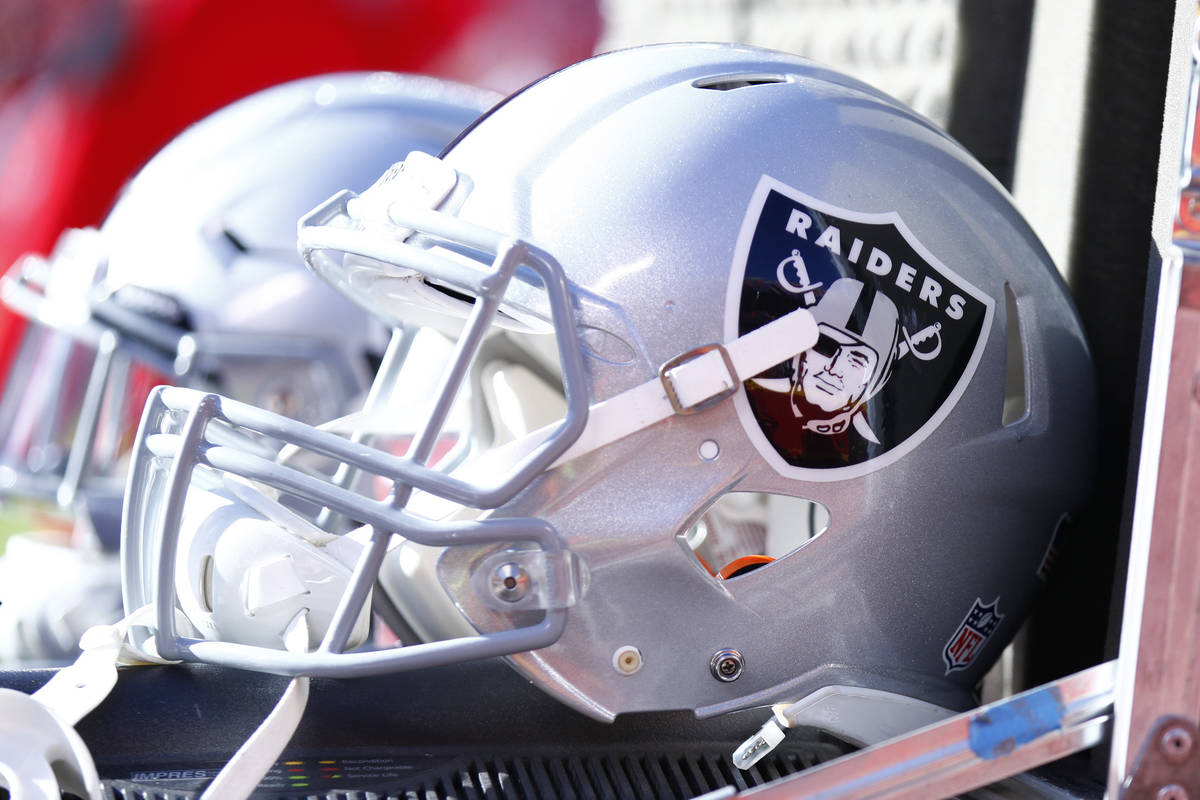 The Oakland Raiders helmets lay in an equipment box on the team's sideline during the first hal ...