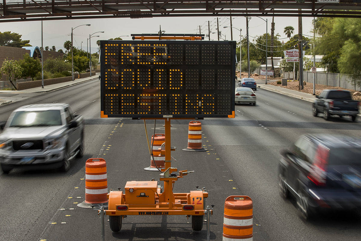 An electric sign along South Lamb Boulevard announces a pop-up COVID-19 testing site now operat ...