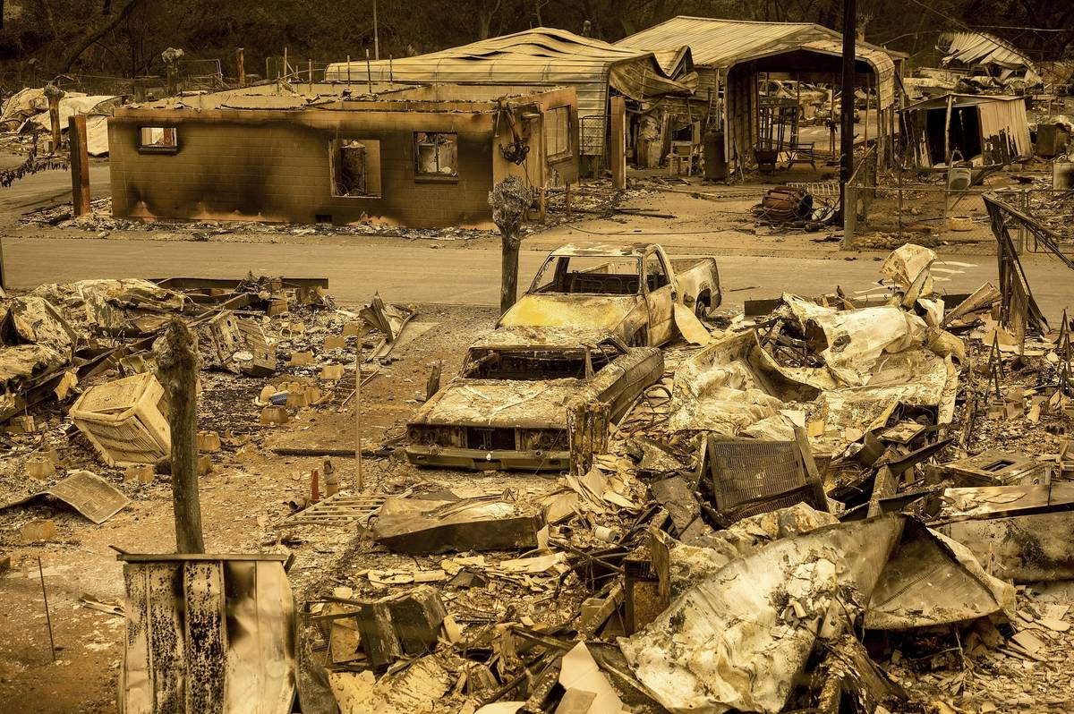 FILE - In this Aug. 20, 2020, file photo, scorched homes and vehicles fill Spanish Flat Mobile ...