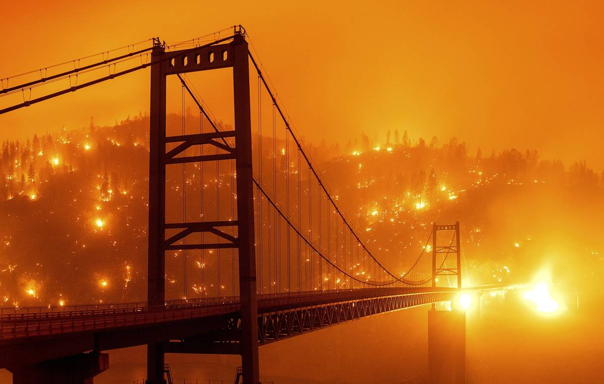 FILE - In this Sept. 9, 2020, file image taken with a slow shutter speed, embers light up a hil ...