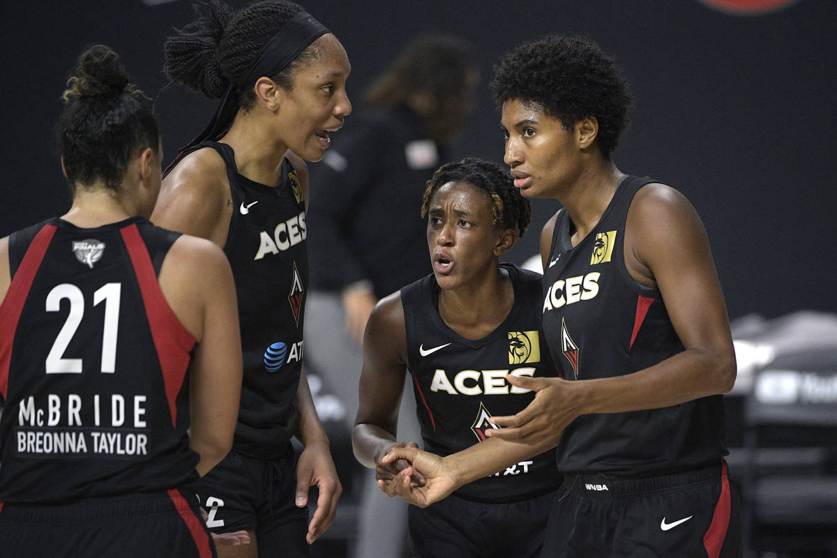 Las Vegas Aces guard Kayla McBride (21), center A'ja Wilson (22), guard Danielle Robinson, seco ...