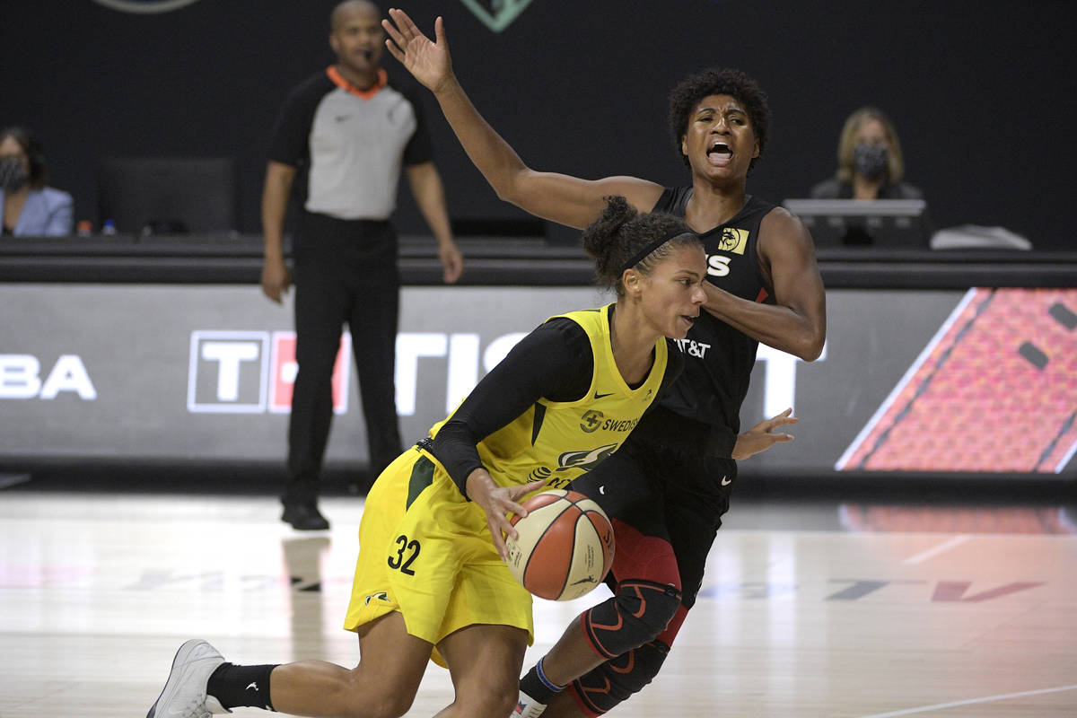 Seattle Storm forward Alysha Clark (32) is fouled by Las Vegas Aces forward Angel McCoughtry wh ...