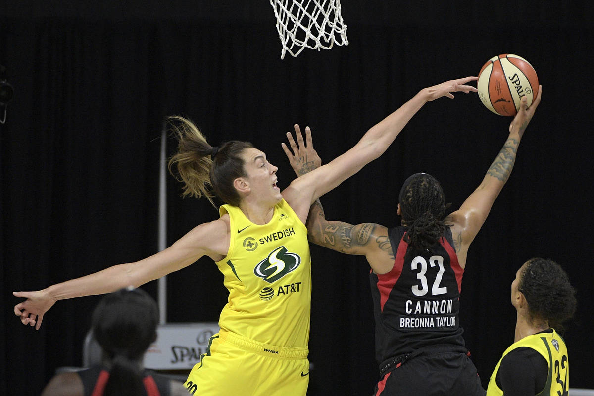 Las Vegas Aces forward Emma Cannon (32) goes up to shoot as Seattle Storm forward Breanna Stewa ...