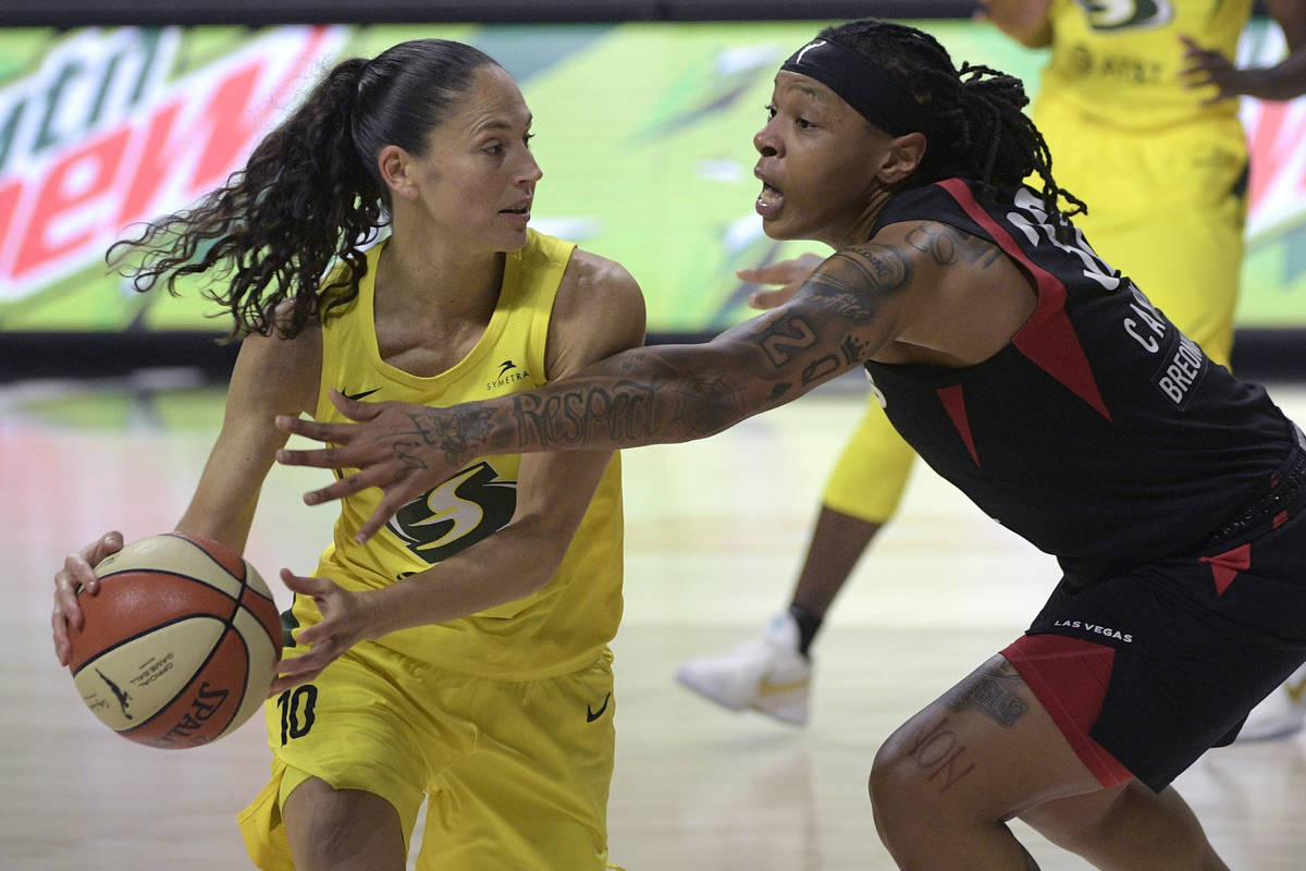 Seattle Storm guard Sue Bird (10) is defended by Las Vegas Aces forward Emma Cannon (32) during ...