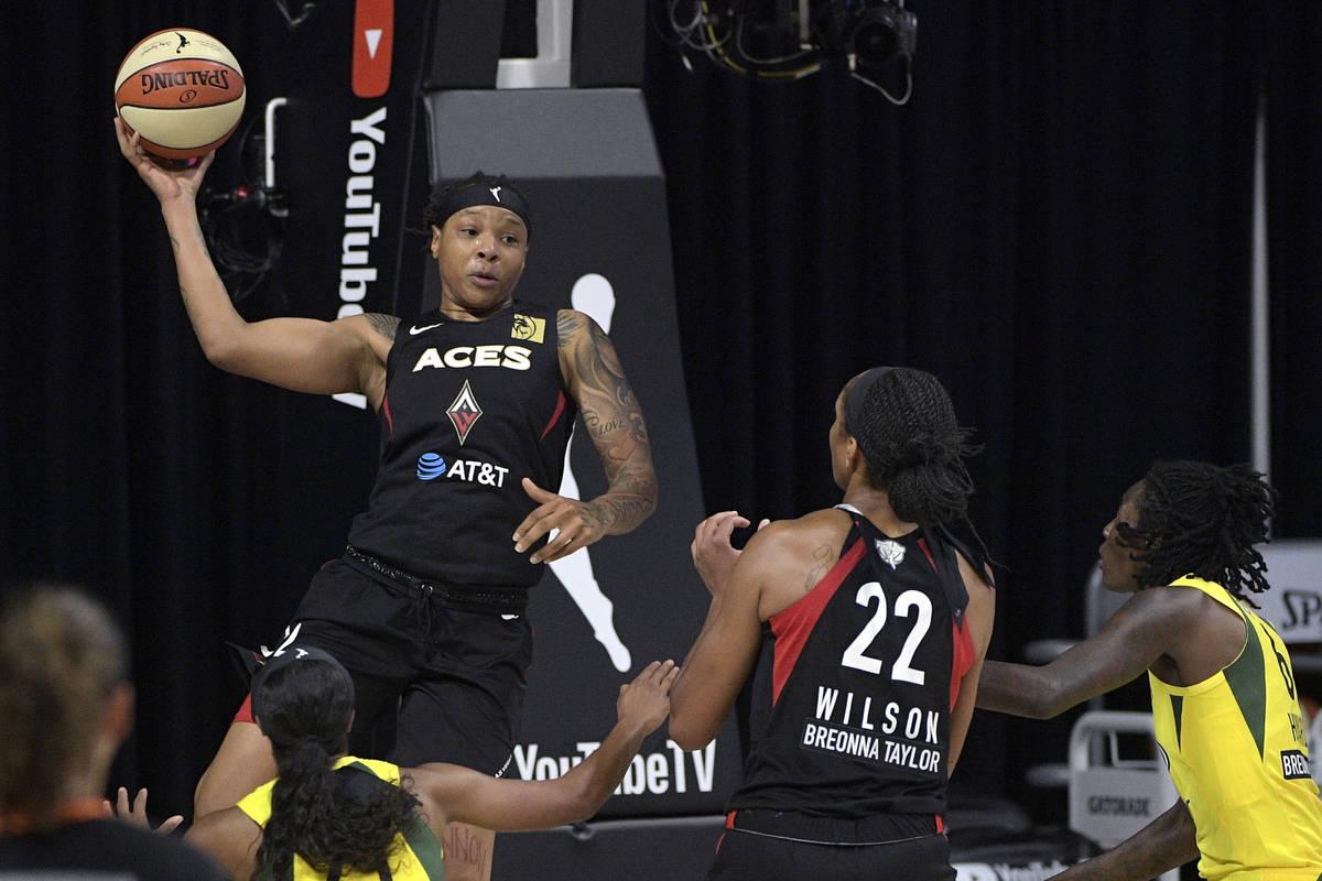 Las Vegas Aces forward Emma Cannon, top left, passes the ball to center A'ja Wilson (22) as Sea ...