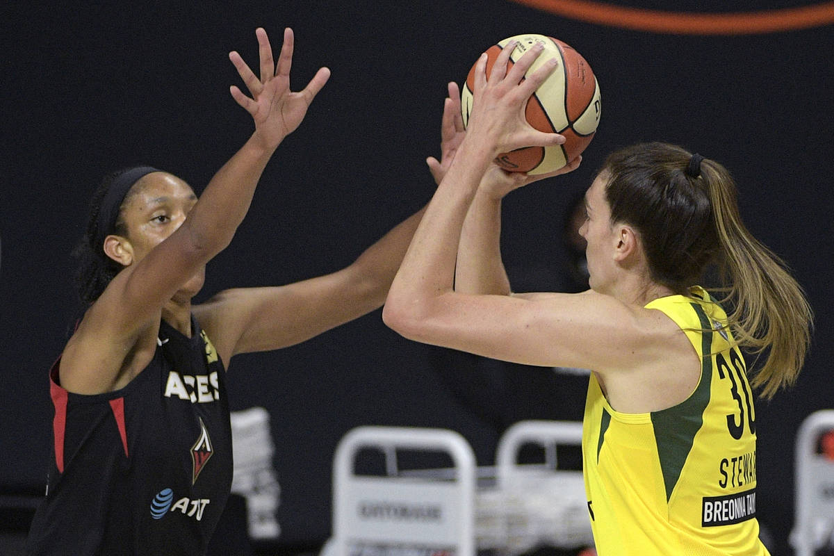 Seattle Storm forward Breanna Stewart (30) goes up to shoot in front of Las Vegas Aces center A ...