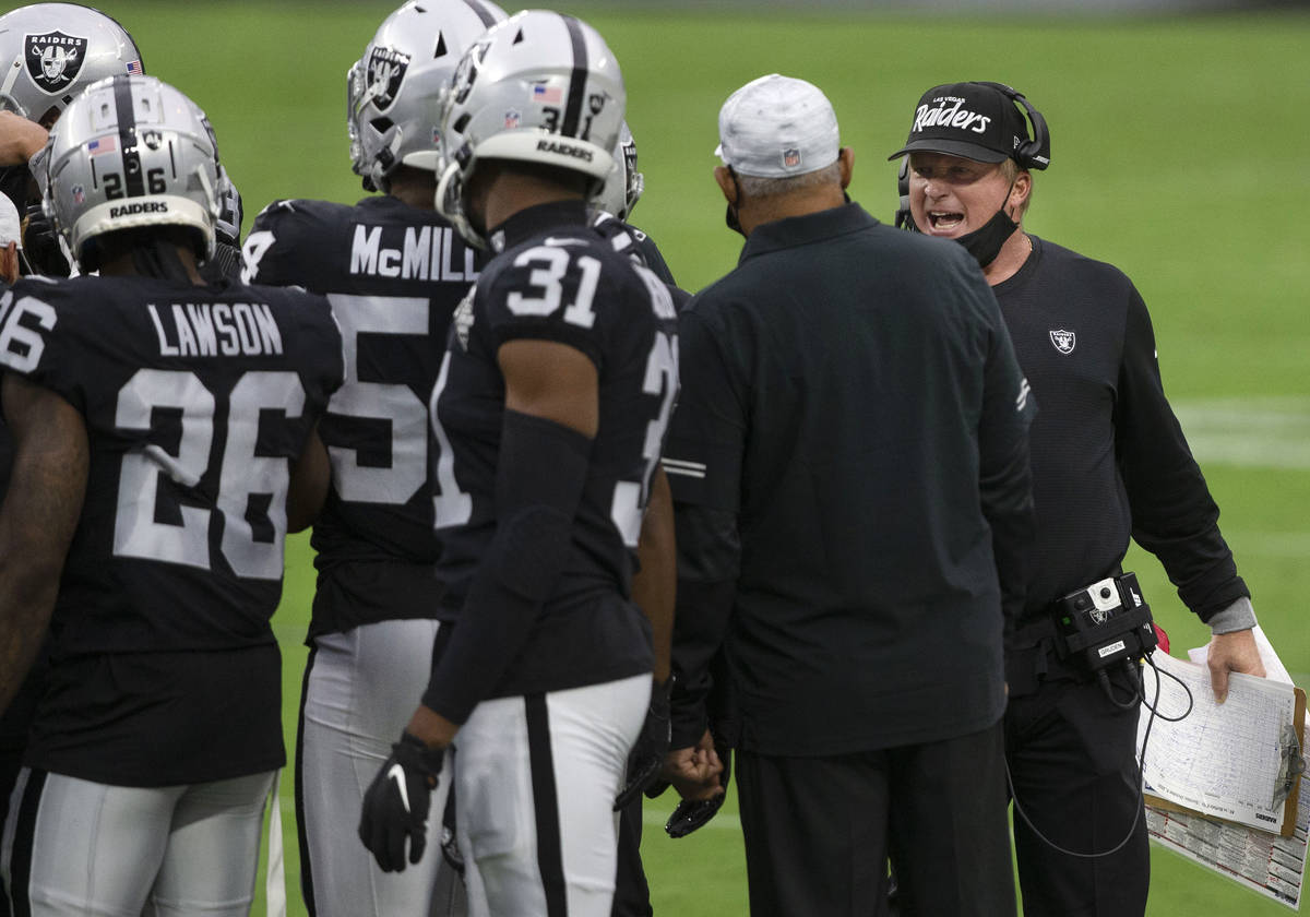 Las Vegas Raiders head coach Jon Gruden speaks to his players on the sideline during the 2nd qu ...