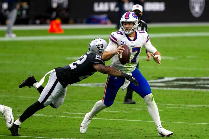 Las Vegas Raiders cornerback Keisean Nixon (22) dives to tackle Buffalo Bills quarterback Josh ...
