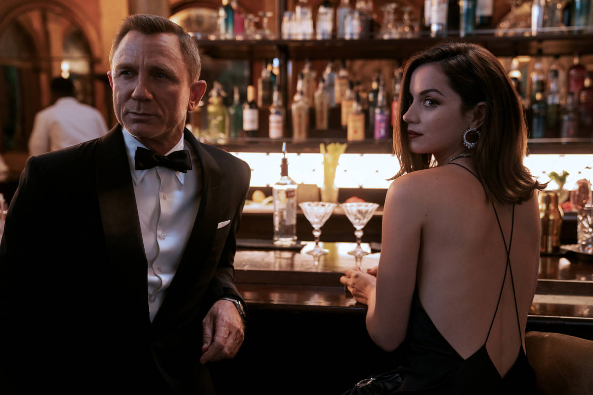 """James Bond (Daniel Craig) and Paloma (Ana de Armas) star in """"No Time to Die,"""" whose opening dat ..."""