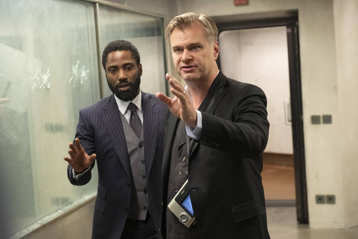 John David Washington, left, and director/writer/producer Christopher Nolan on the set of Warne ...