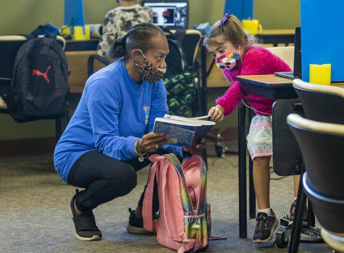 Instructor Donna Abnathy, left, assists Ayla Vines in their first and second grade classroom wi ...