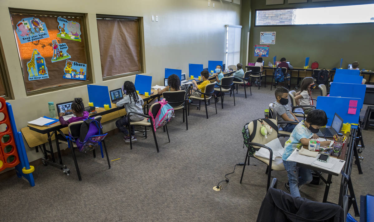 First and second graders work independently at their desks as they do classwork in the Vegas St ...