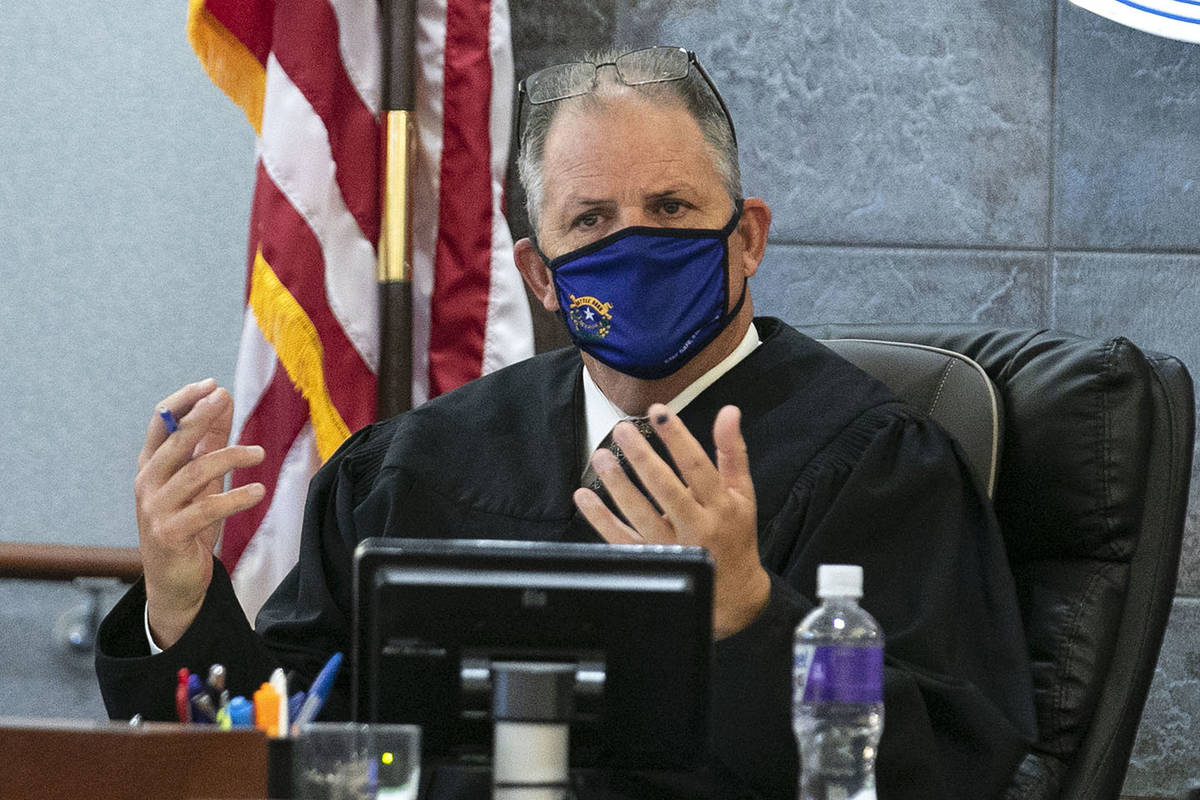 District Judge David Jones presides over a hearing at the Regional Justice Center on whether to ...