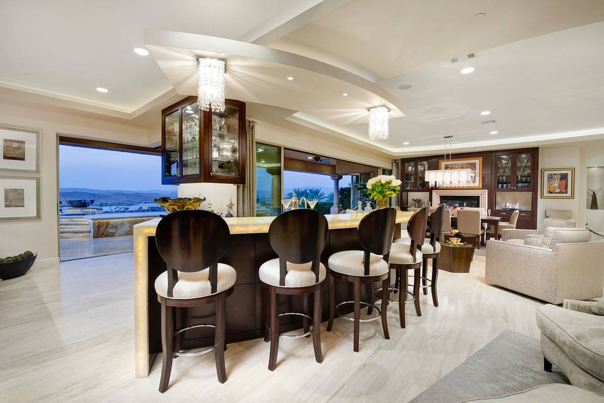 The home was designed for entertaining and features disappearing walls. The kitchen leads to th ...