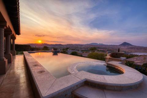 This Lake Las Vegas home has views of the desert mountains, golf course and the man-made lake. ...