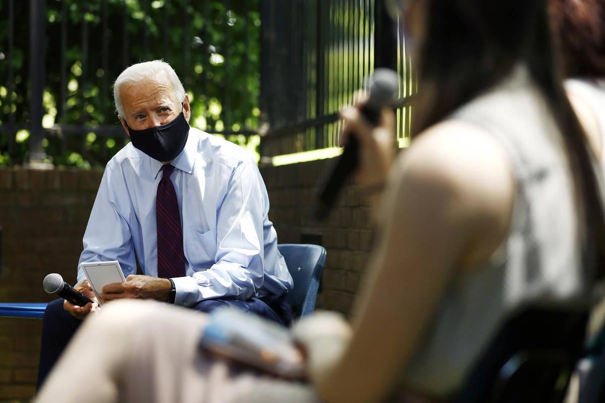 Democratic presidential candidate Joe Biden, left. (AP Photo/Matt Slocum)