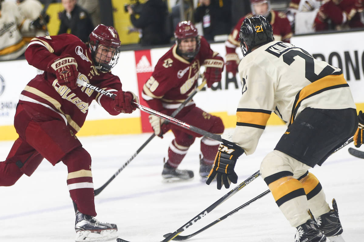 Boston College's Graham McPhee (27) attempts a shot against Michigan Tech during the Ice Vegas ...