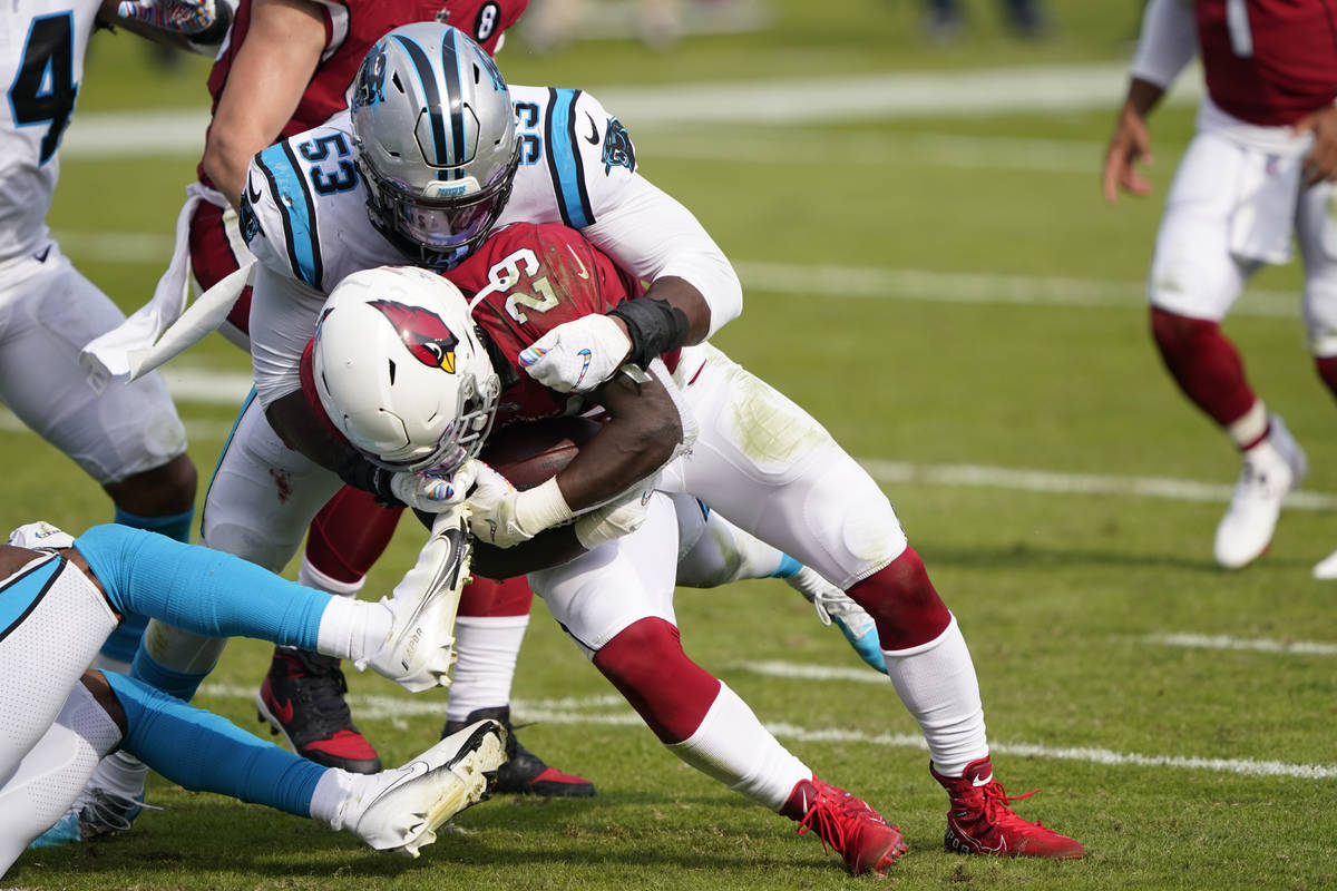 Arizona Cardinals running back Chase Edmonds is tackled by Carolina Panthers defensive end Bria ...