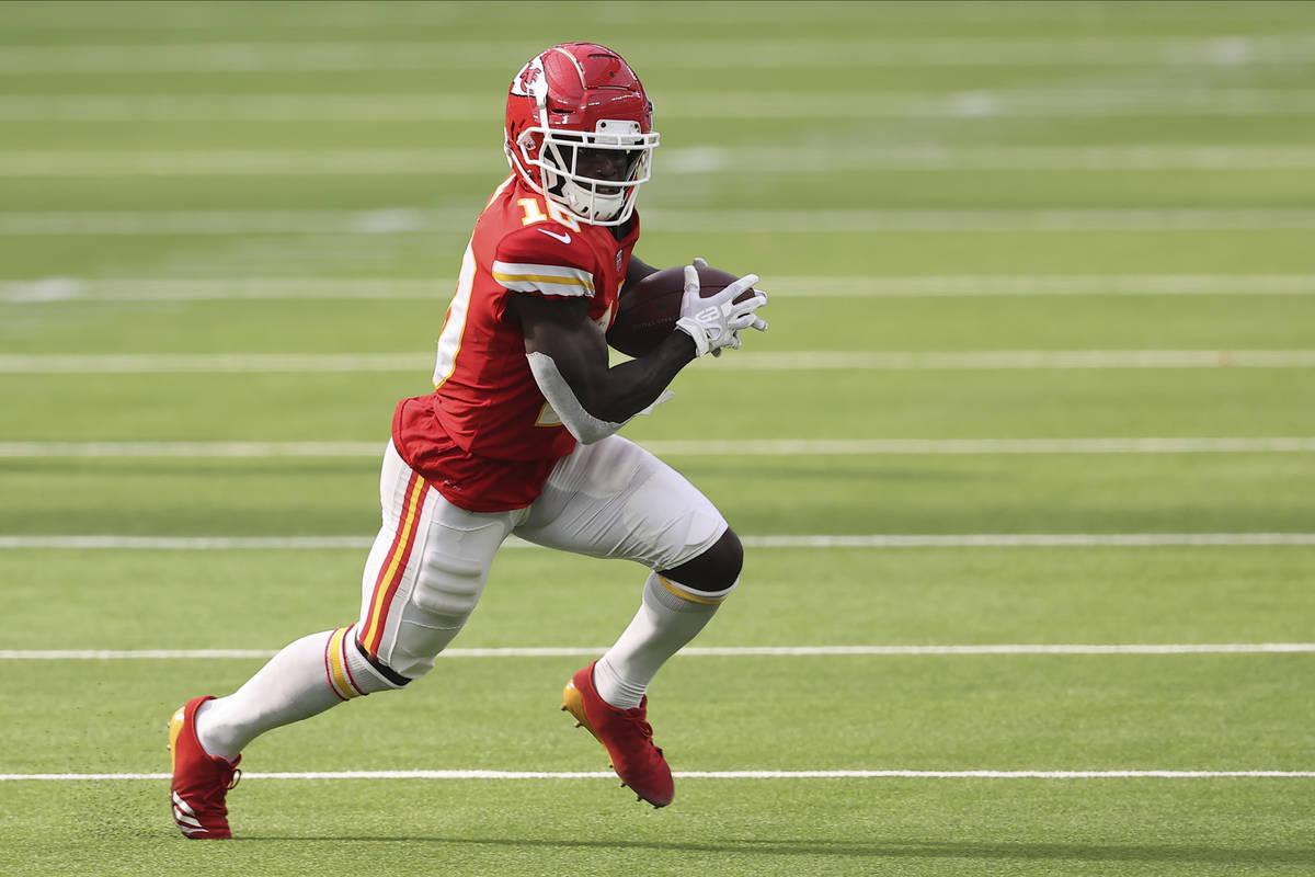 Kansas City Chiefs wide receiver Tyreek Hill (10) runs after the catch during an NFL football g ...