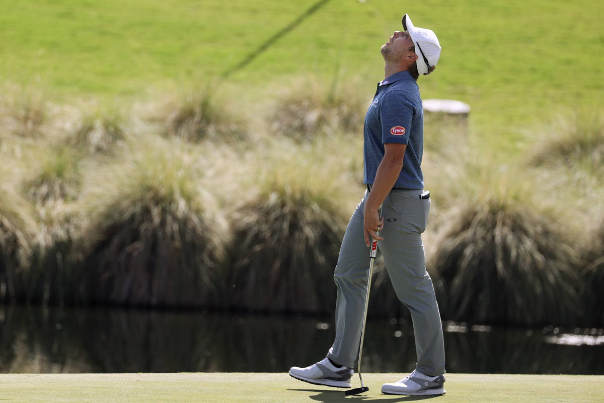Austin Cook reacts after missing a putt at the 18th hole during round one the 2020 Shriners Hos ...