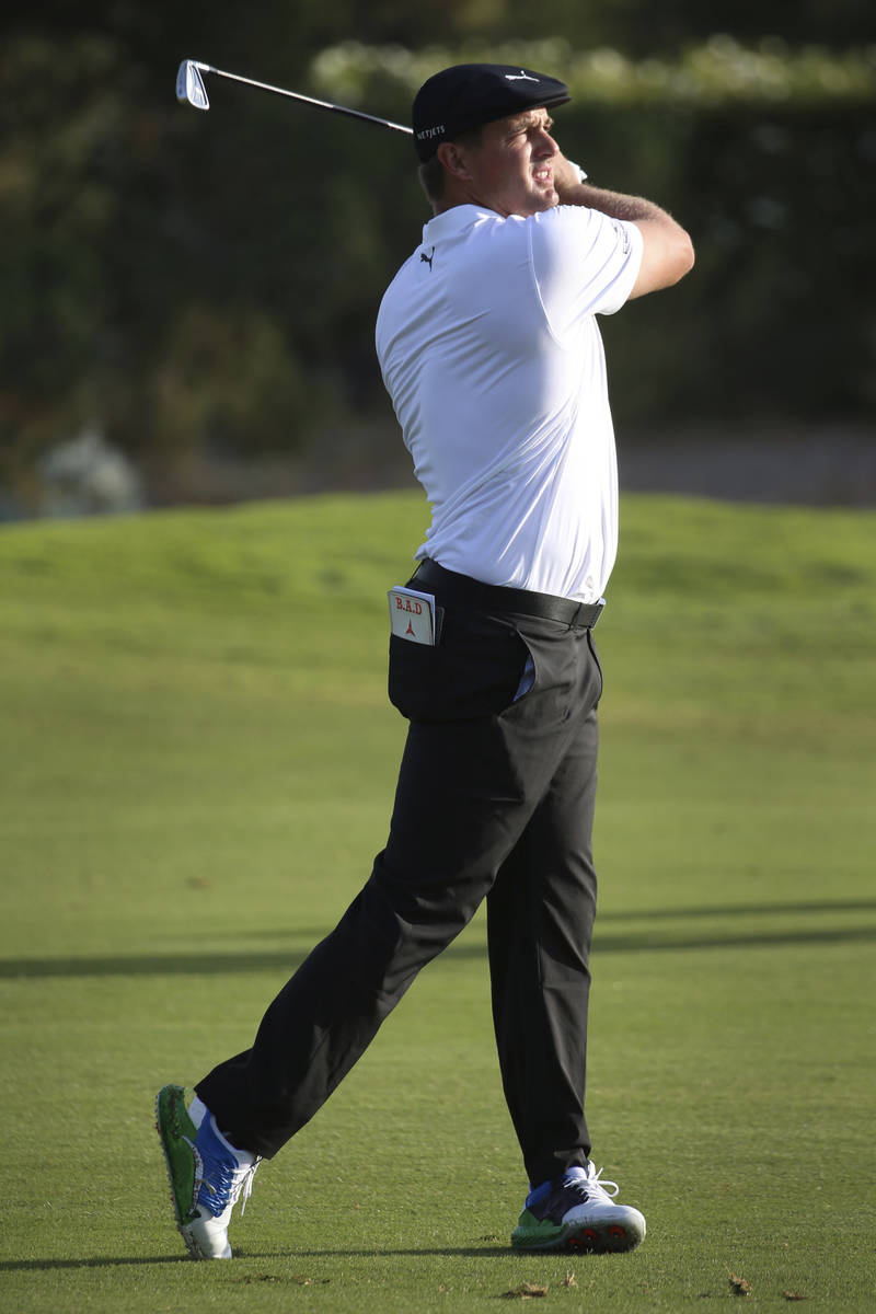 Bryson DeChambeau watches a shot on the 13th hole during the first round of the Shriners Hospit ...