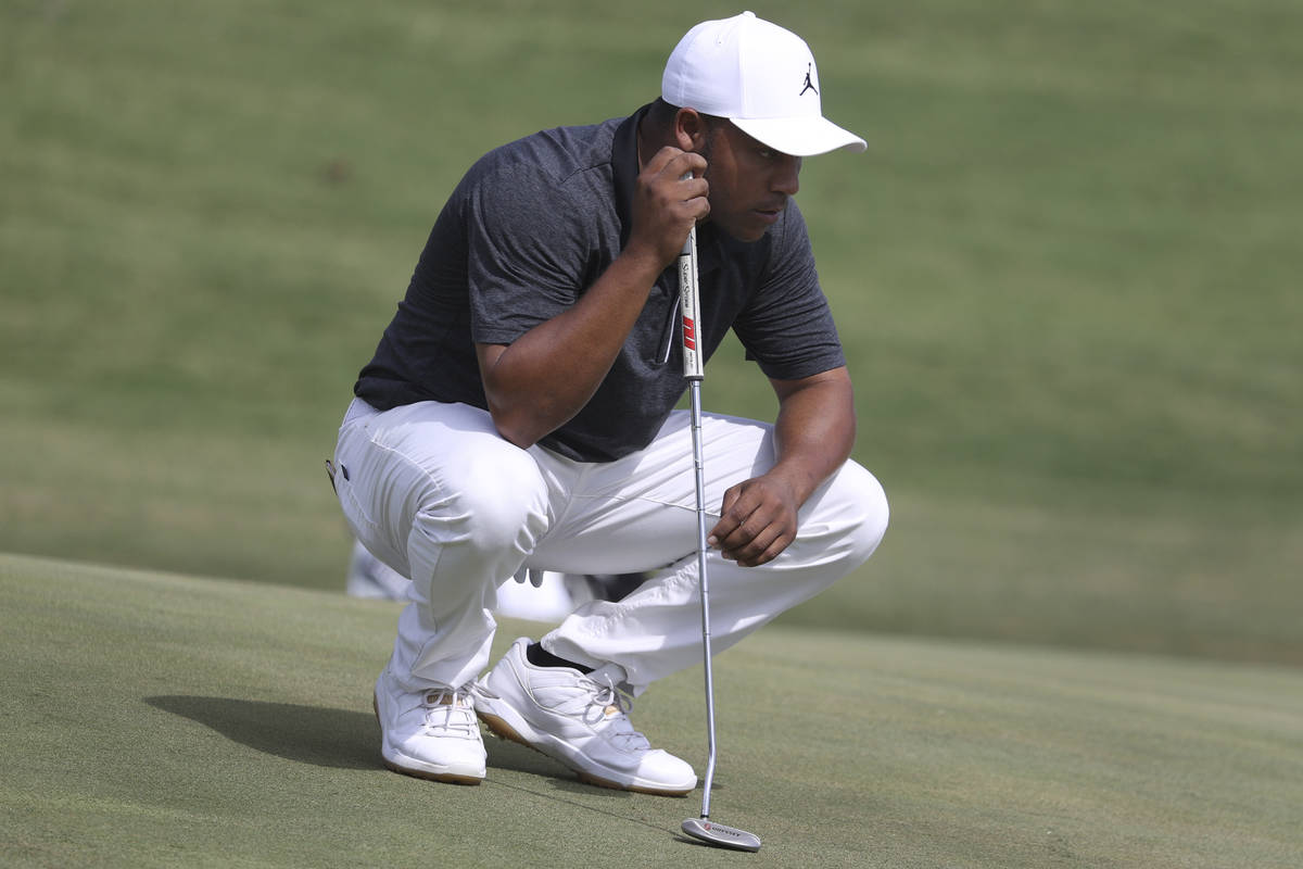 Harold Varner III gets ready to putt on the ninth hole during the first round of the Shriners H ...