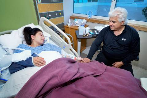 Michael Marotta, right, visits with his daughter Regina Marotta as she recovers from surgery to ...