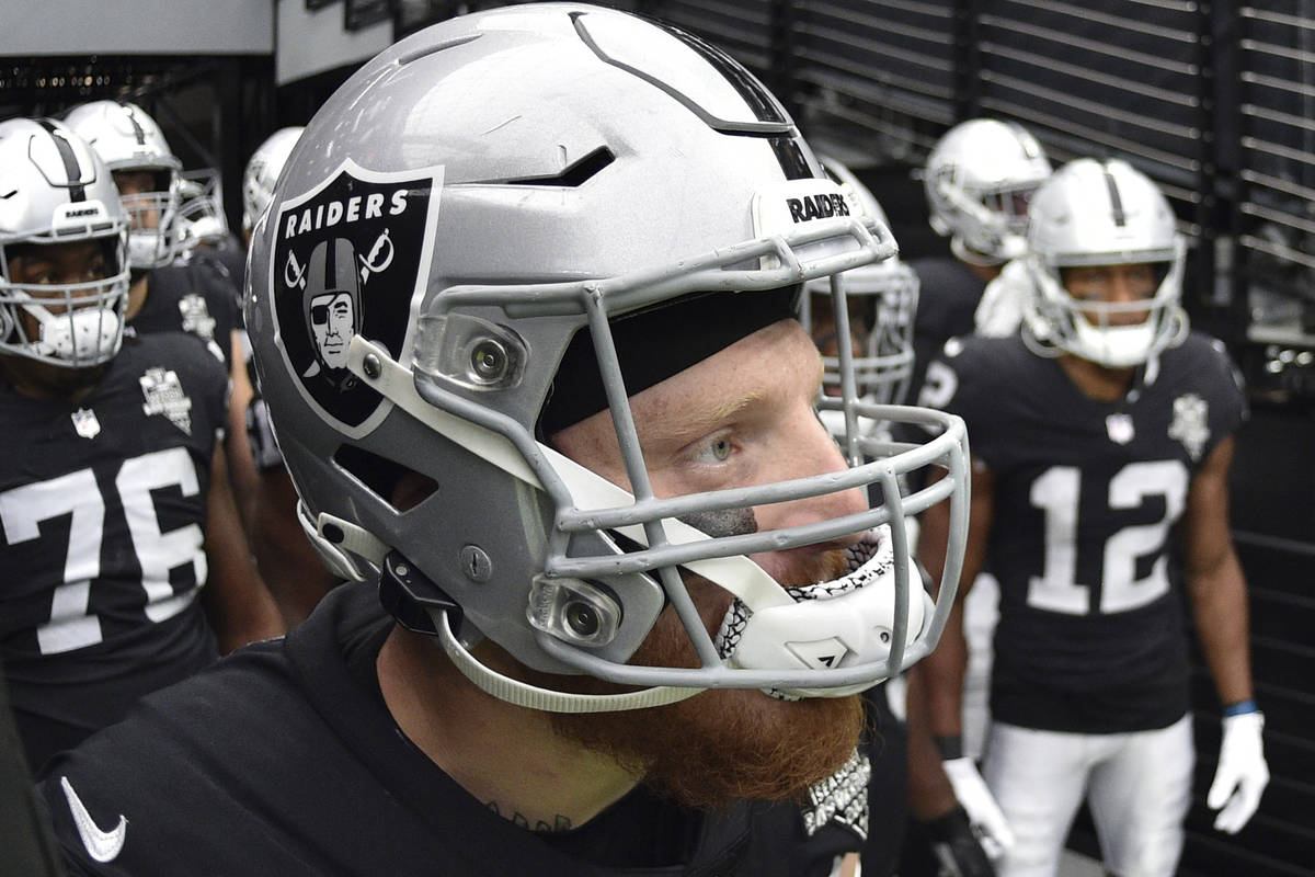 Las Vegas Raiders defensive end Maxx Crosby (98) and his teammates line up before taking the fi ...