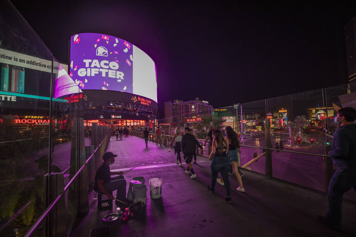 Tourists are seen on the Las Vegas Strip, early Thursday, Oct. 8, 2020. (Elizabeth Brumley/Las ...