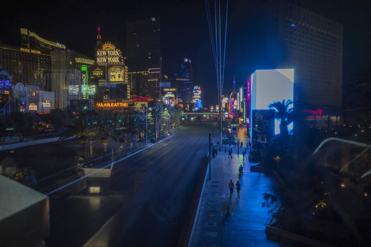 Individuals walk the Las Vegas Strip, early Thursday, Oct. 8, 2020. (Elizabeth Brumley/Las Vega ...