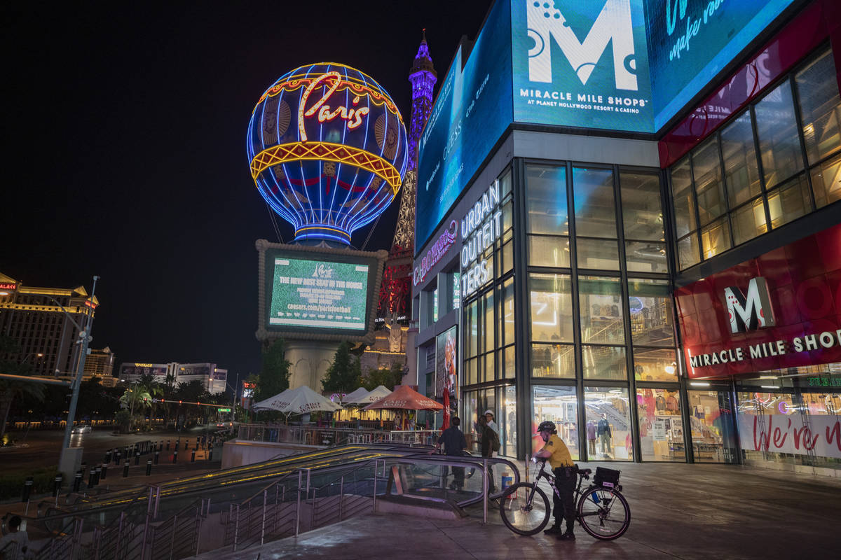 A security guard is seen outside of the Miracle Mile Shops entrance on the Las Vegas Strip, ear ...