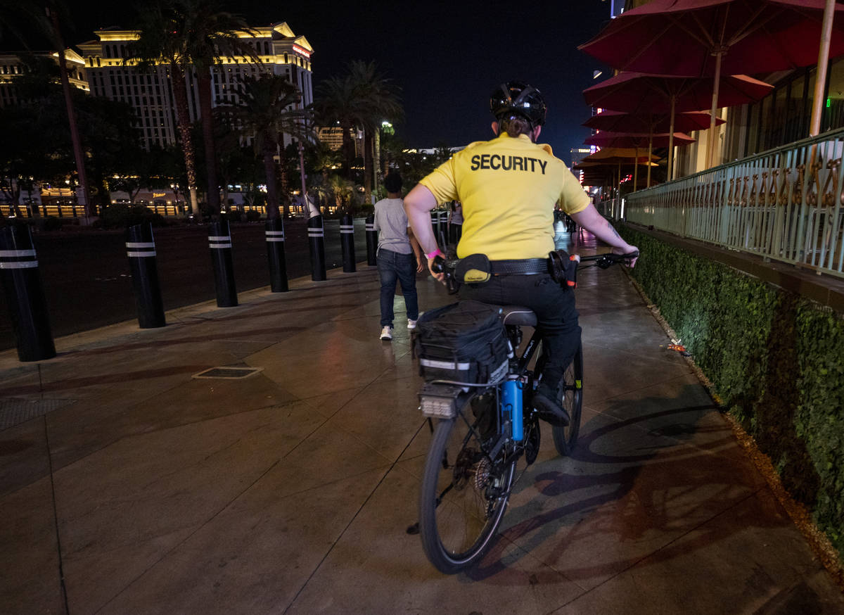A security guard bikes near the Paris Hotel and Casino on the Las Vegas Strip, early Thursday, ...