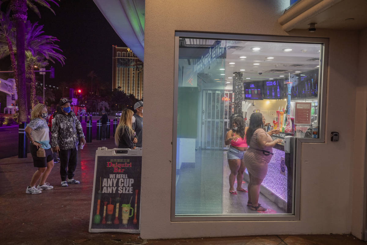 Tourists are seen purchasing drinks from Breeze Daiquiri Bar attached to HarrahÕs on the L ...