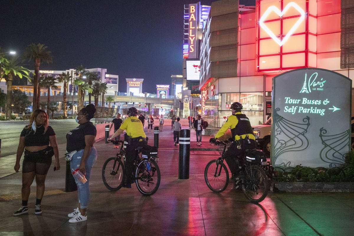 Security guards bike near the Paris Hotel and Casino on the Las Vegas Strip, early Thursday, Oc ...