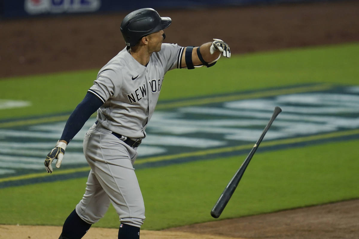 New York Yankees' Giancarlo Stanton tosses his bat after he hit a three-run home run to score L ...