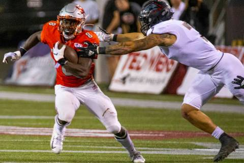 UNLV Rebels running back Charles Williams (8) looks to break a tackle attempt by Southern Utah ...