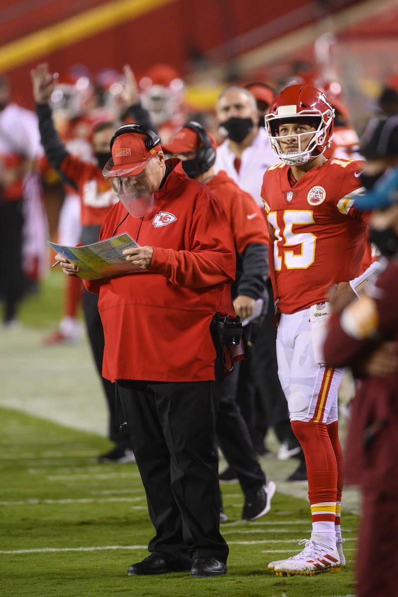 Kansas City Chiefs head coach Andy Reid and Kansas City Chiefs quarterback Patrick Mahomes (15) ...