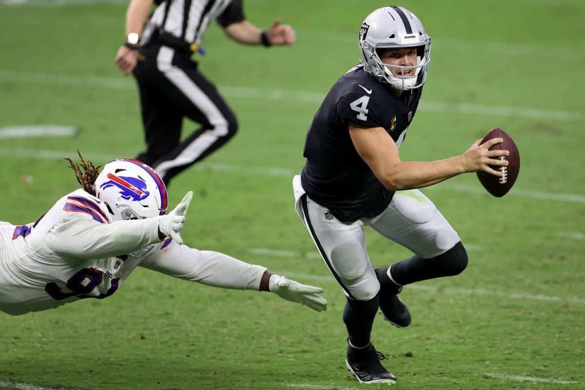 Las Vegas Raiders quarterback Derek Carr (4) is pressured by Buffalo Bills defensive tackle Ver ...