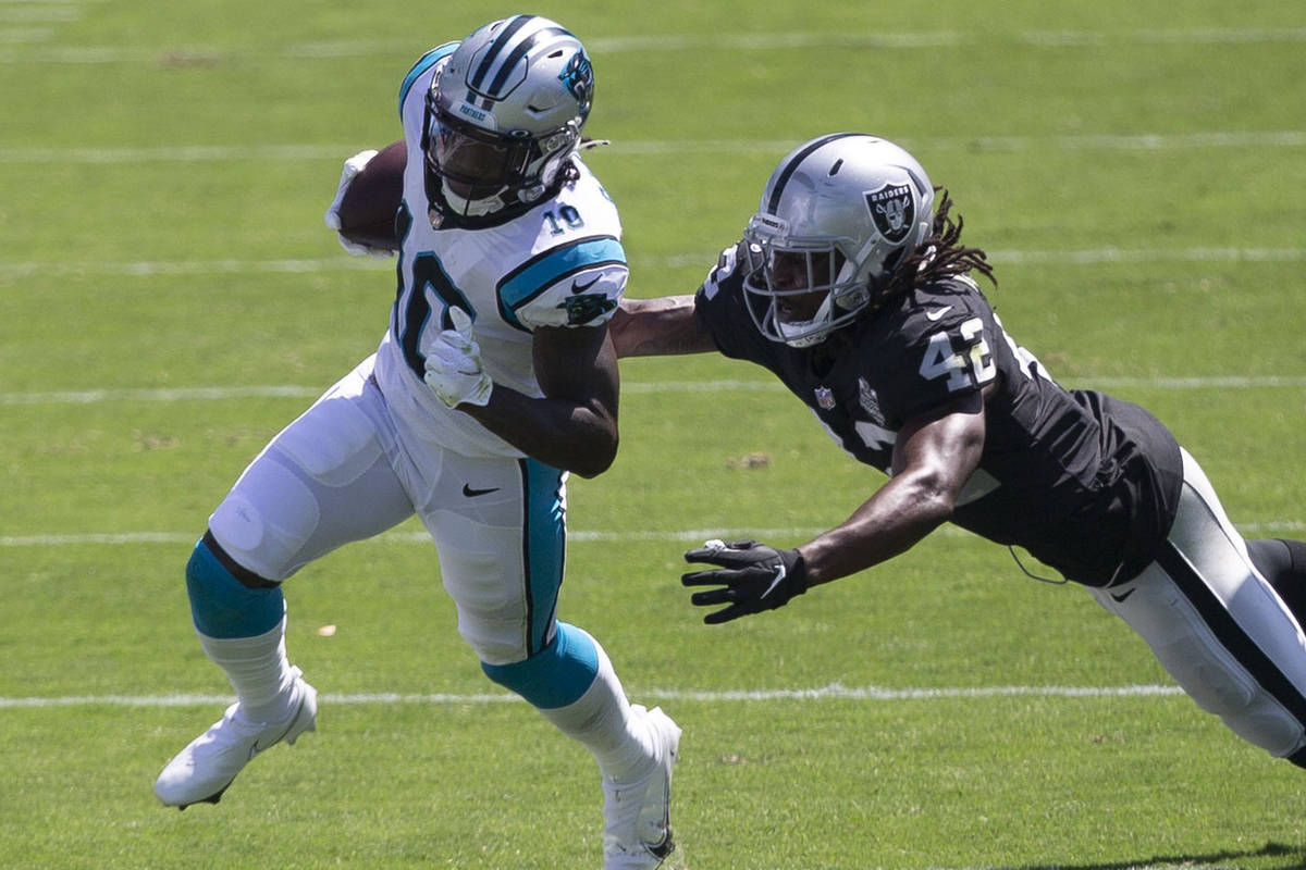 Las Vegas Raiders linebacker Cory Littleton (42) tries to tackle Carolina Panthers wide receive ...